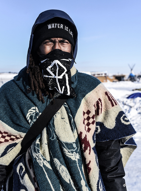 "Kane Wolf is an Apache descendant from the South Side of Chicago. "" If you're coming here for spiritual enlightenment you came to the wrong place. We're here to fight. We've been doing this for 500 years, and it's the same fight. Water or oil? You just go"